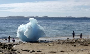 Children play amid icebergs on the beach in Nuuk, Greenland, 5 June  2016