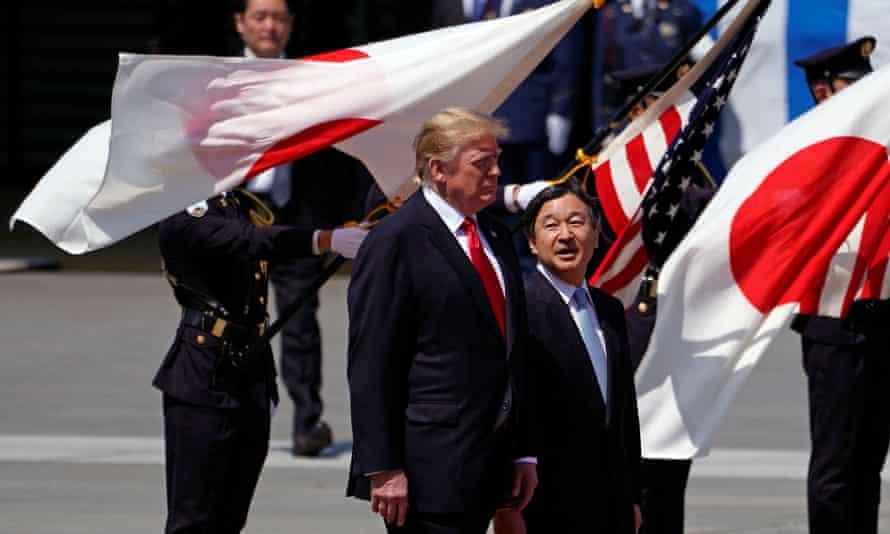 Donald Trump is escorted by Japan's Emperor Naruhito in Tokyo