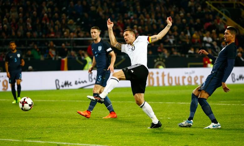 Podolski shoots.