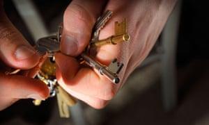 Man holding bunch of keys