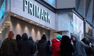 Customers queue in April to enter a Primark store in Birmingham, as it reopens its doors after a third lockdown imposed in early January.