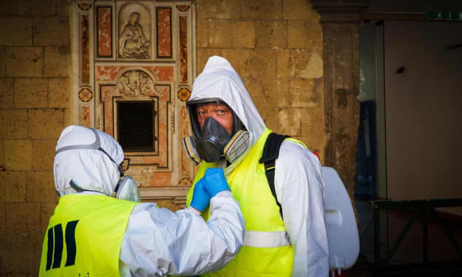 Staff deep-cleaning the Maschio Angioino castle in Naples, Italy, March 2020