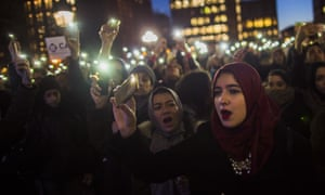 Muslim women protest Donald Trump's order cracking down on immigrants living in the US at Washington Square Park in New York.