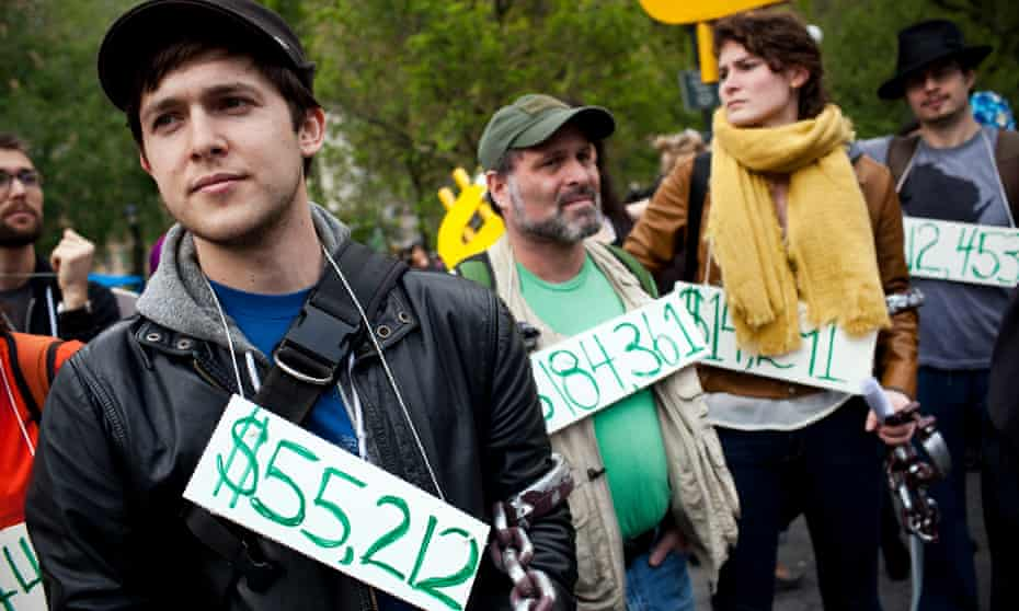 Demonstrators wear signs around their necks representing their student debt during a protest in New York on 25 April 2012.
