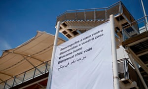 A banner reading 'Welcome home' greets migrants aboard the rescue ship Aquarius. Barcelona has pledged to take in 100 of the 629 refugees on board.