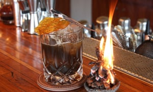 The Night Rooster's signature cocktail, Ashes – a mixture of rye whiskey, vodka, wine and dehydrated fruits.