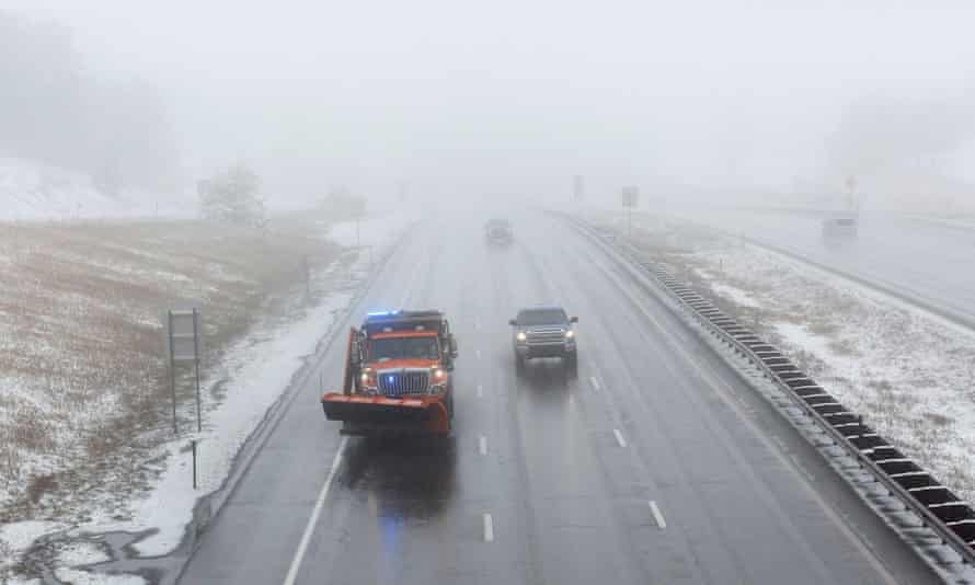 A snowplow patrols in Colorado on Saturday in the initial hours of a winter storm which meteorologists predict could bring several feet of snow to parts of the state.