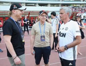 Avram Glazer (left) and Joel Glazer (centre) talk with Jose Mourinho on the club's tour of Asia in 2016