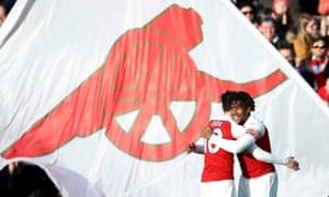 Arsenal's Alex Iwobi celebrates scoring their third goal with Mesut Ozil.