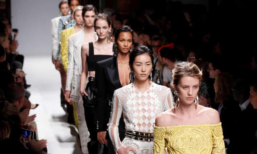 Catwalk models wear Balmain during Paris fashion week.