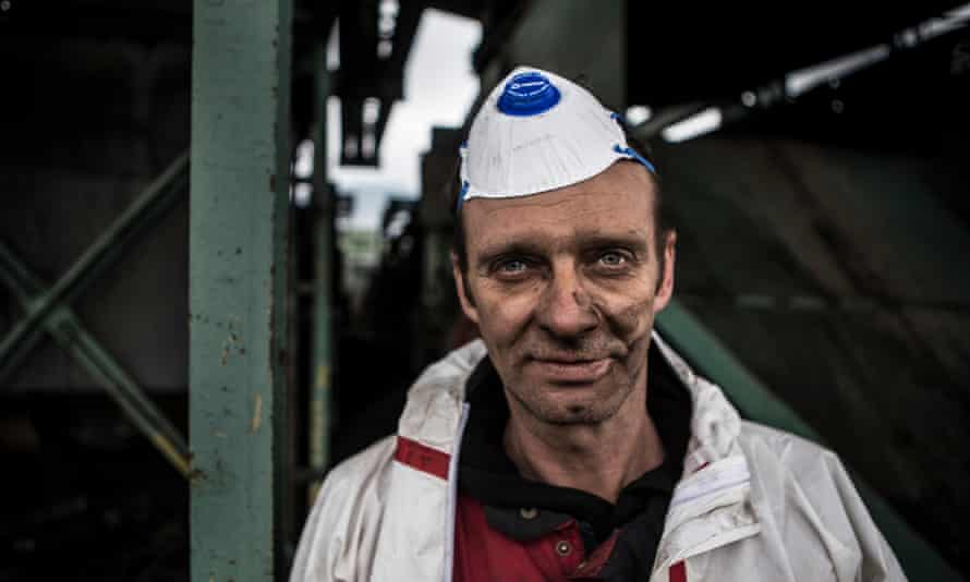 The coal-smeared face of a worker.