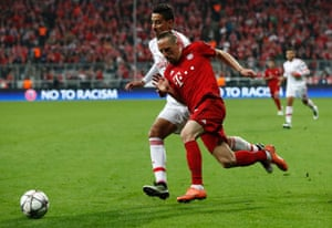 Bayern's Franck Ribery, right, surges forward.