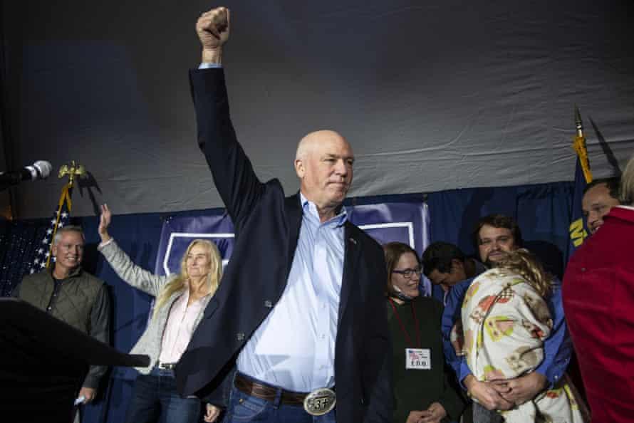 Greg Gianforte raises his fist after the Montana gubernatorial race was called by the Associated Press in Bozeman, Montana.