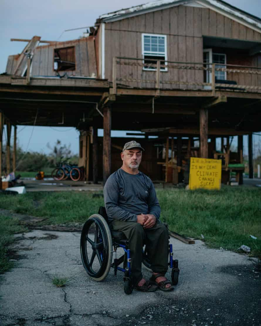 Chris Brunet at his partially destroyed home in Isle de Jean Charles