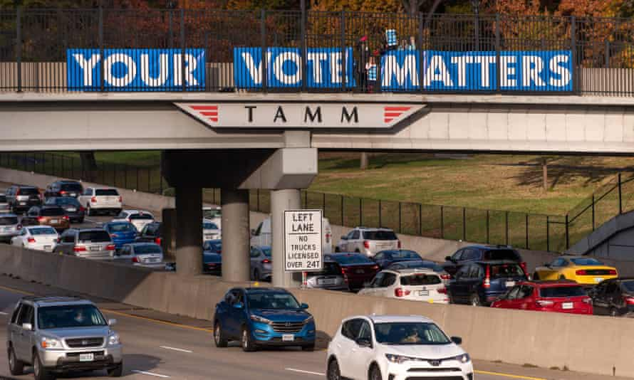 Members of the group Your Vote Matters place signs on an overpass in Saint Louis, Missouri on 6 November 2018.