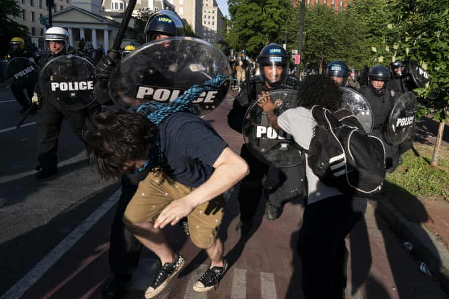 Police holding the DMS riot shields clash with protesters during a demonstration on 1 June in Washington, DC.