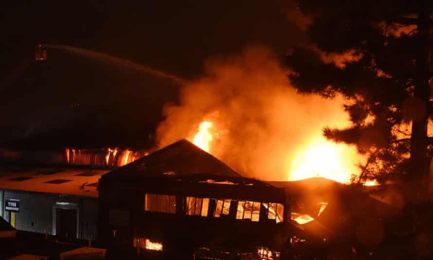 Firefighters battle a warehouse blaze on White Hart Lane in Tottenham, London.