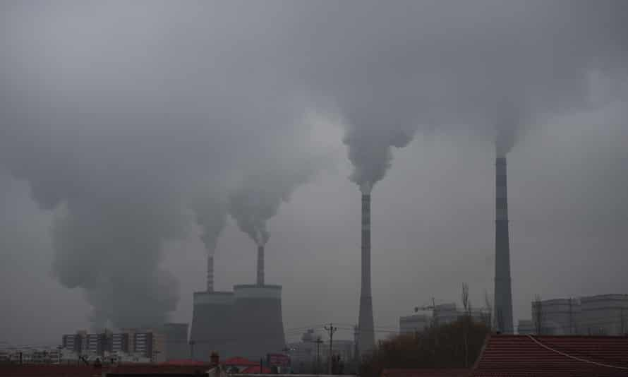 In this photo taken on November 19, 2015, smoke belches from a coal-fired power station near Datong, in China's northern Shanxi province.
