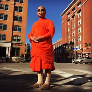 Woraphon, 26, a buddhist monk from Thailand who lives in New Mexico, visits the Texas School Book Depository and surrounding streets that mark the events where JFK was assassinated by Lee Harvey Oswald