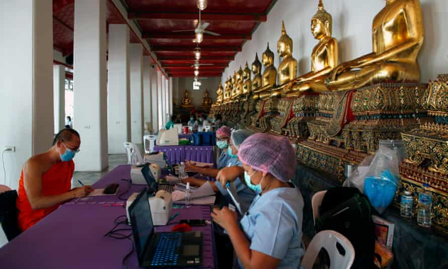 A Thai Buddhist monk registers for a Covid-19 swab test at Wat Pho temple in Bangkok in May.