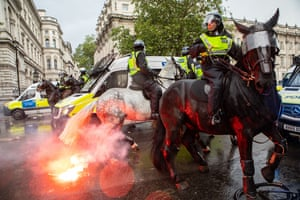 A flare spooks a police horse outside the entrance to Downing Street during the Black Lives Matter protests in Whitehall, London.