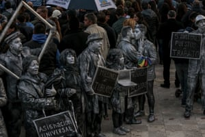 Demonstrators dressed in costume protest the current administration during a campaign rally held by Alberto Fernandez, presidential candidate for the Citizen's Unity Party, and his running mate Cristina Fernandez de Kirchner not pictured, in Merlo, Argentina, on Saturday, May 25, 2019. Kirchner decided to run as a vice-presidential candidate in upcoming elections, stunning many who believed she'd positioned herself to return to the top job by choosing Fernandez to top the ticket as a way to broaden their combined electoral appeal.