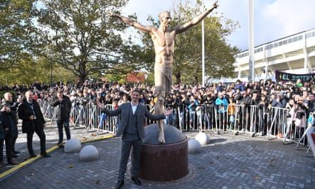 Zlatan Ibrahimovic poses in front of the statue after it was unveiled in October.