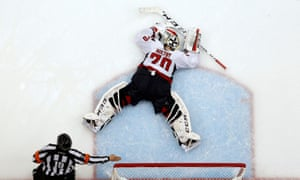 Braden Holtby lies dejected in the goalmouth after the Capitals' loss against Pittsburgh.