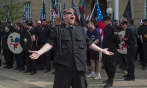 A neo-Nazi goads anti-fascist protesters at opposing demonstrations