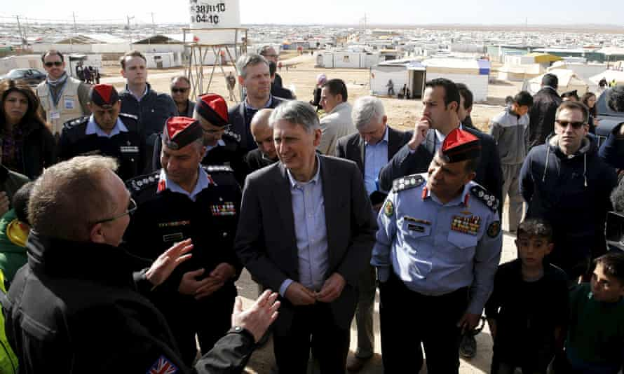 UK foreign secretary Philip Hammond, centre, during his visit to Zaatari refugee camp in Jordan.