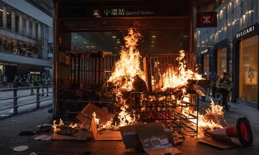 Protesters started a fire at an entrance to the mass transit railway system in the city's Central district.