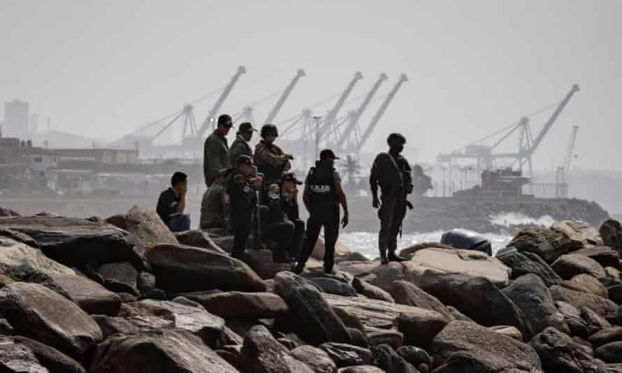 Authorities patrol the coast where an alleged confrontation took place in Macuto, La Guaira, Venezuela, on 3 May.