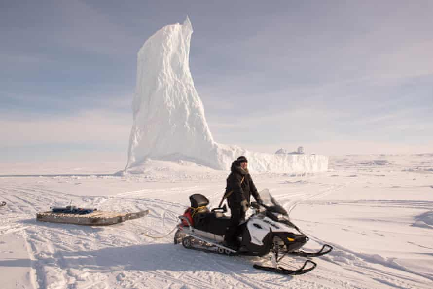 """A """"smart qamutiq"""" – a traditional sledge fitted out with sensors that is towed behind a snowmobile along routes the community use most ."""