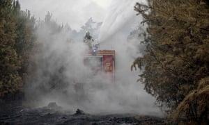 A firefighter Firemen work in Treuenbrietzen near Berlin.