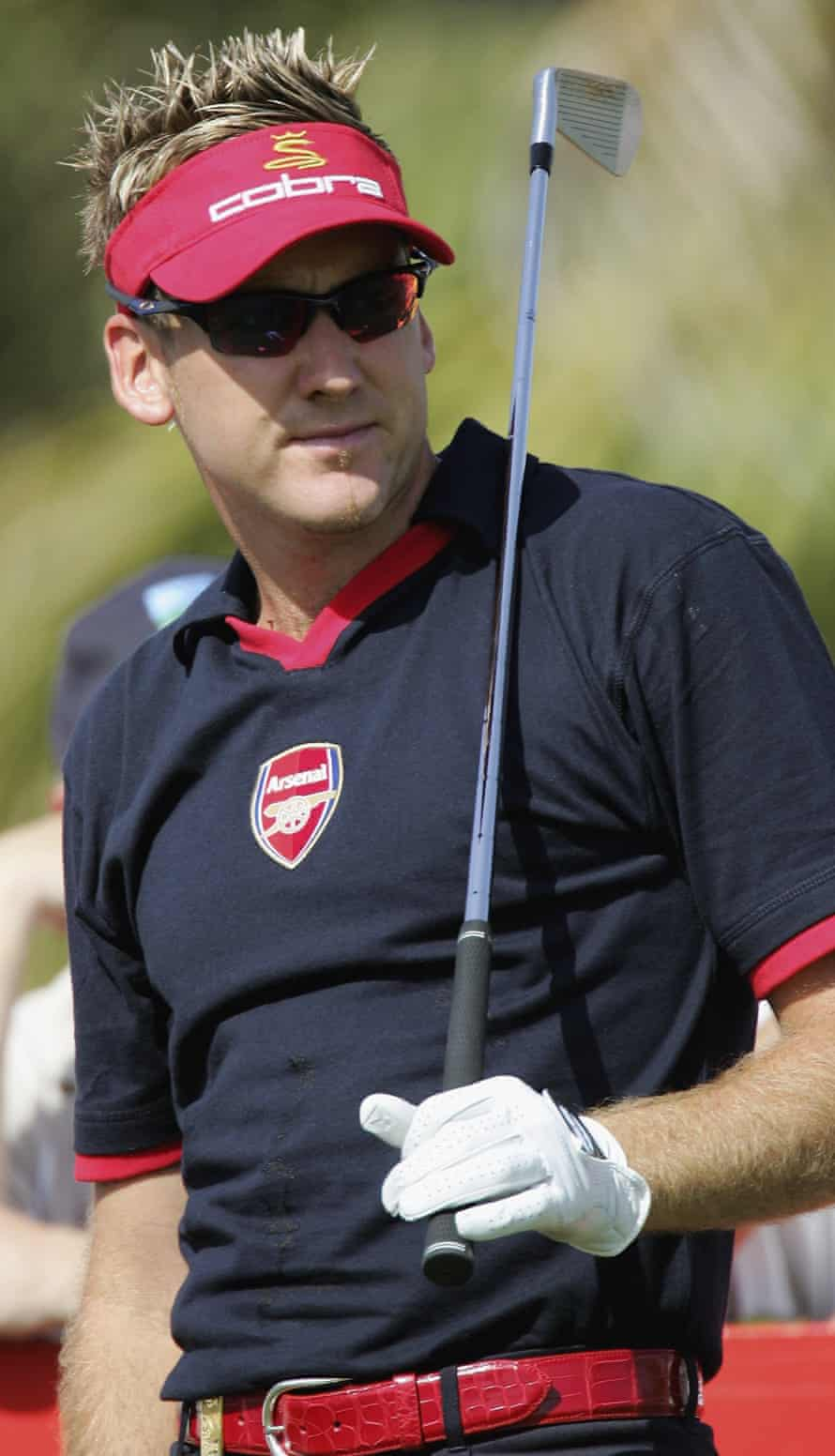 Ian Poulter wears an Arsenal shirt during the first round of the Dubai Desert Classic in February 2006.