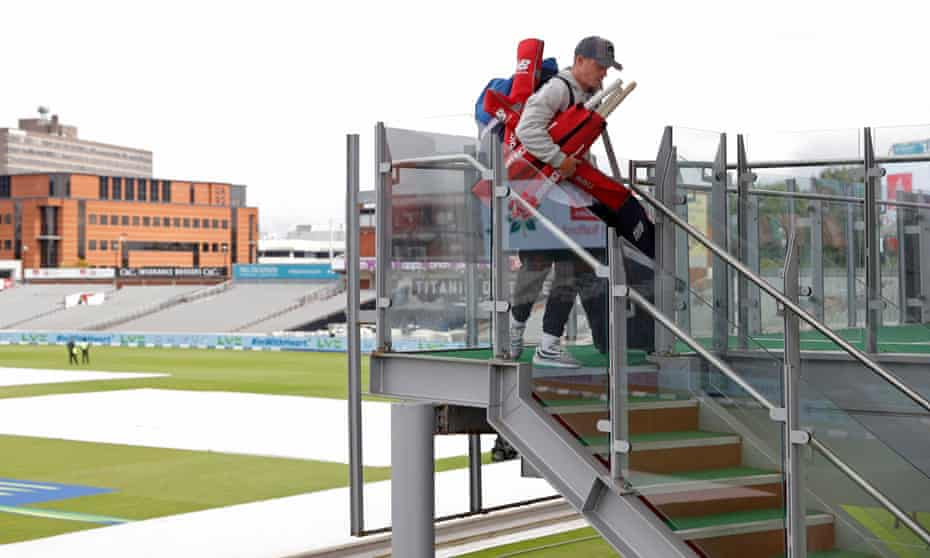 England's Ollie Pope carrying his equipment out of the home dressing room.