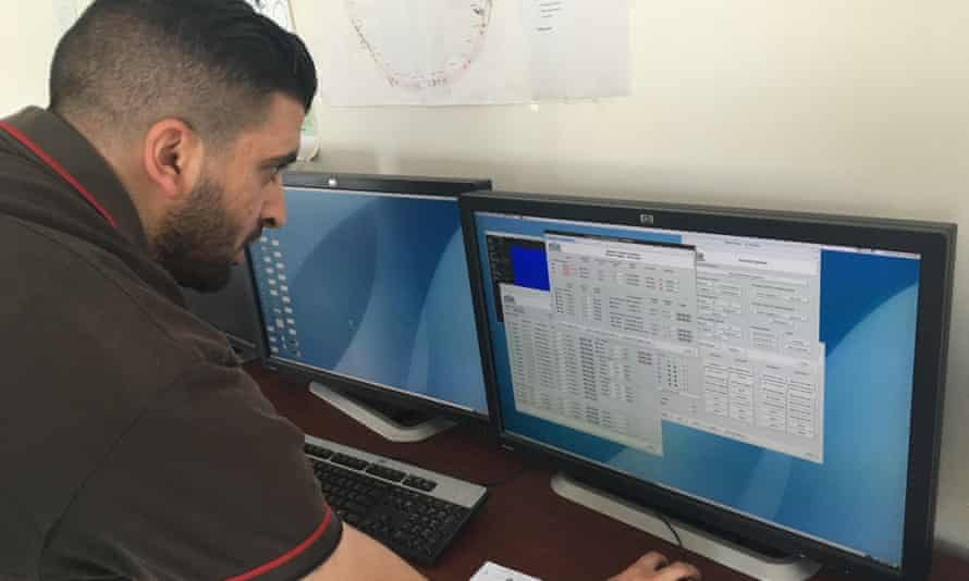 A worker looks at research data at the Sesame facility.