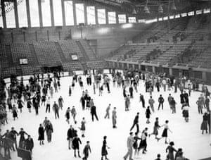 A large group of people ice skating at Wembley, 1937
