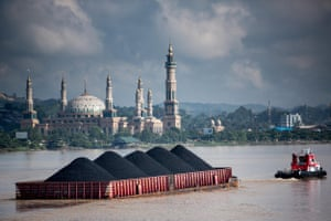 Coal barges come down the Mahakam river in Samarinda, East Kalimantan, Indonesian Borneo every few minutes.