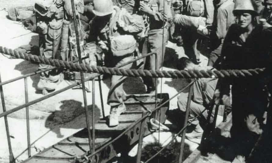 Stephen Weiss, far right, boarding a troop ship during the second world war