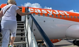 Passengers board an EasyJet domestic flight at an airport in the United Kingdom on June 15, 2020 as the low cost carrier resumes flights for the first time since the March 2020 coronavirus lockdown.