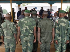 Men are tried for rape by a military judge in a mobile court in Oicha, Beni.
