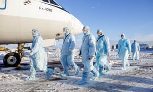 Chelyabinsk Airport employees in Russia take part in an exercise to evacuate aircraft passengers showing symptoms of coronavirus.