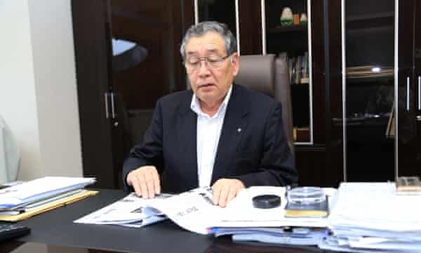 Mayor Toshitsuna Watanabe gets back to work at Okuma's new town hall.