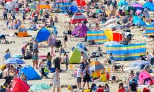 Beachgoers at Lyme Regis