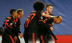 Anthony Martial celebrates with team-mates after putting Manchester United back on level terms.