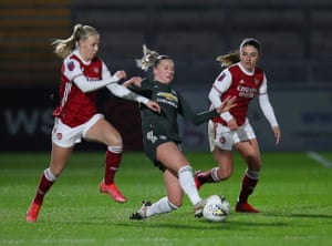 Jackie Groenen of Man United battles for possession with Beth Mead and Danielle Van de Donk.