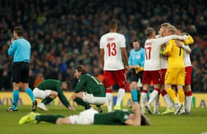 Dejection for the Republic of Ireland players as Kasper Schmeichel celebrates.