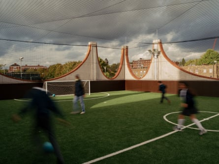 The net-covered rooftop pitch of Plot 10, with its distinctive pinnacled skyline.