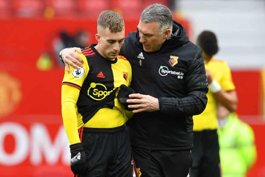 Watford manager Nigel Pearson puts his arm around Watford's Gerard Deulofeu after the Hornets' 3-0 defeat by Manchester United at Old Trafford in February 2020.